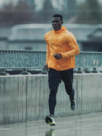 Runner running across a bridge.