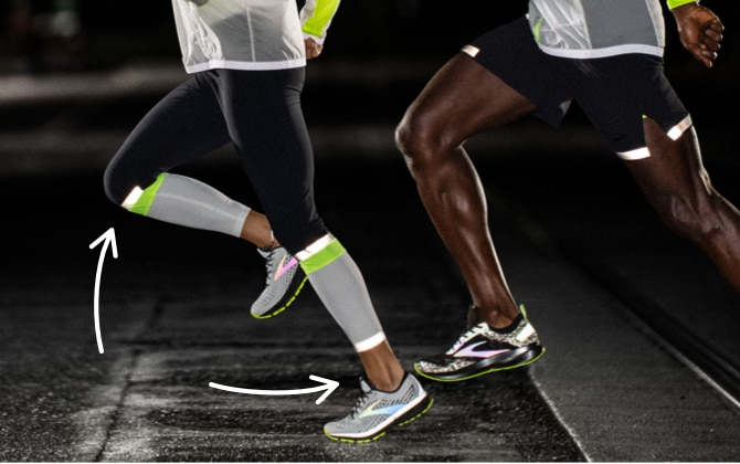 Close-up of a runner's legs in the dark, as she strides forward in the Carbonite 7/8 tight.