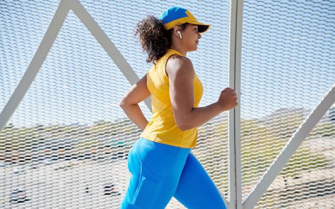 A runner on a pedestrian bridge