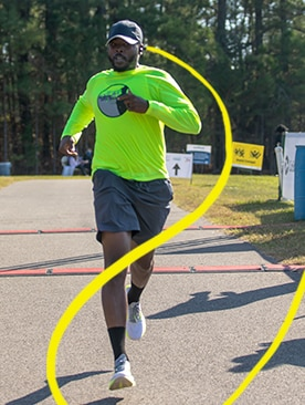 Runner crossing the finish line or a marathon