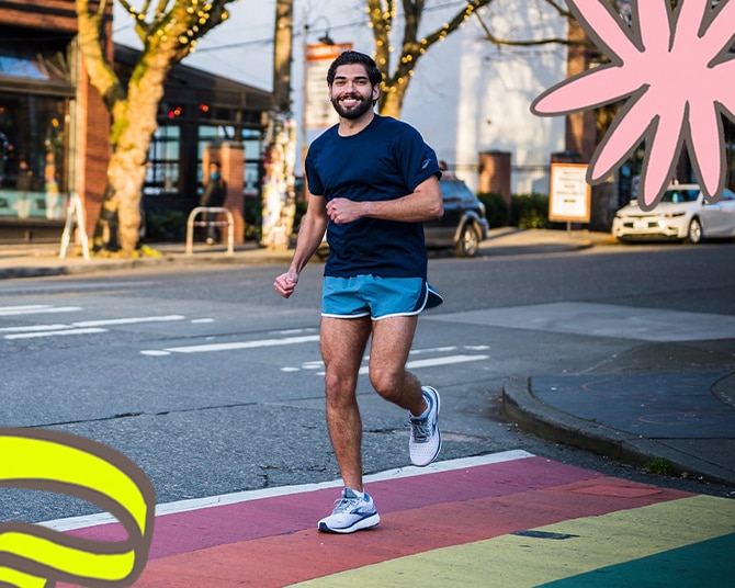 Mikah Meyers, running with illustrations of rainbows in the corner