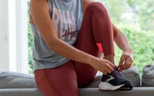 woman lacing up her shoes