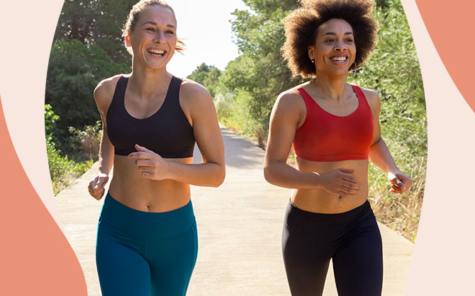 Two women, both wearing Brooks run bras from the Dare Collection, enjoy a run together.