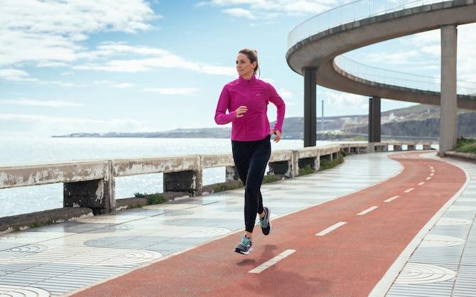 Woman running on a boardwalk track