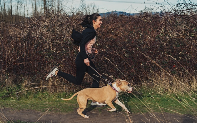 Women mid run with her pup