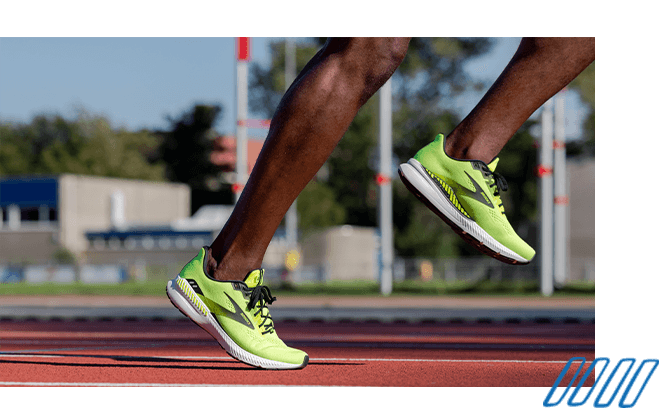 Close up photo of the legs of two runners wearing Brooks Launch GTS 8 shoes with GuideRails technology.