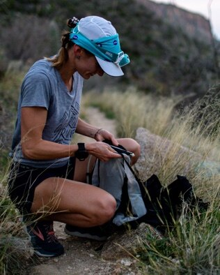 A woman packing her backpack