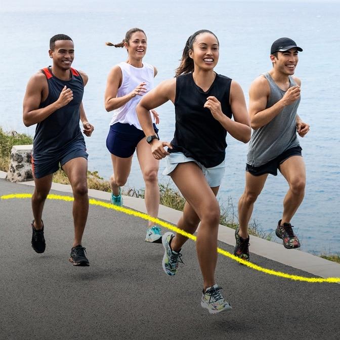 Runners running on the coast
