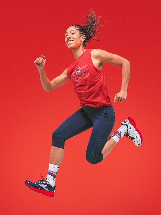Woman jumping with run USA apparel on