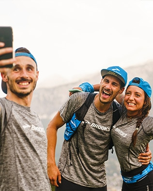 Two men and a woman taking a selfie