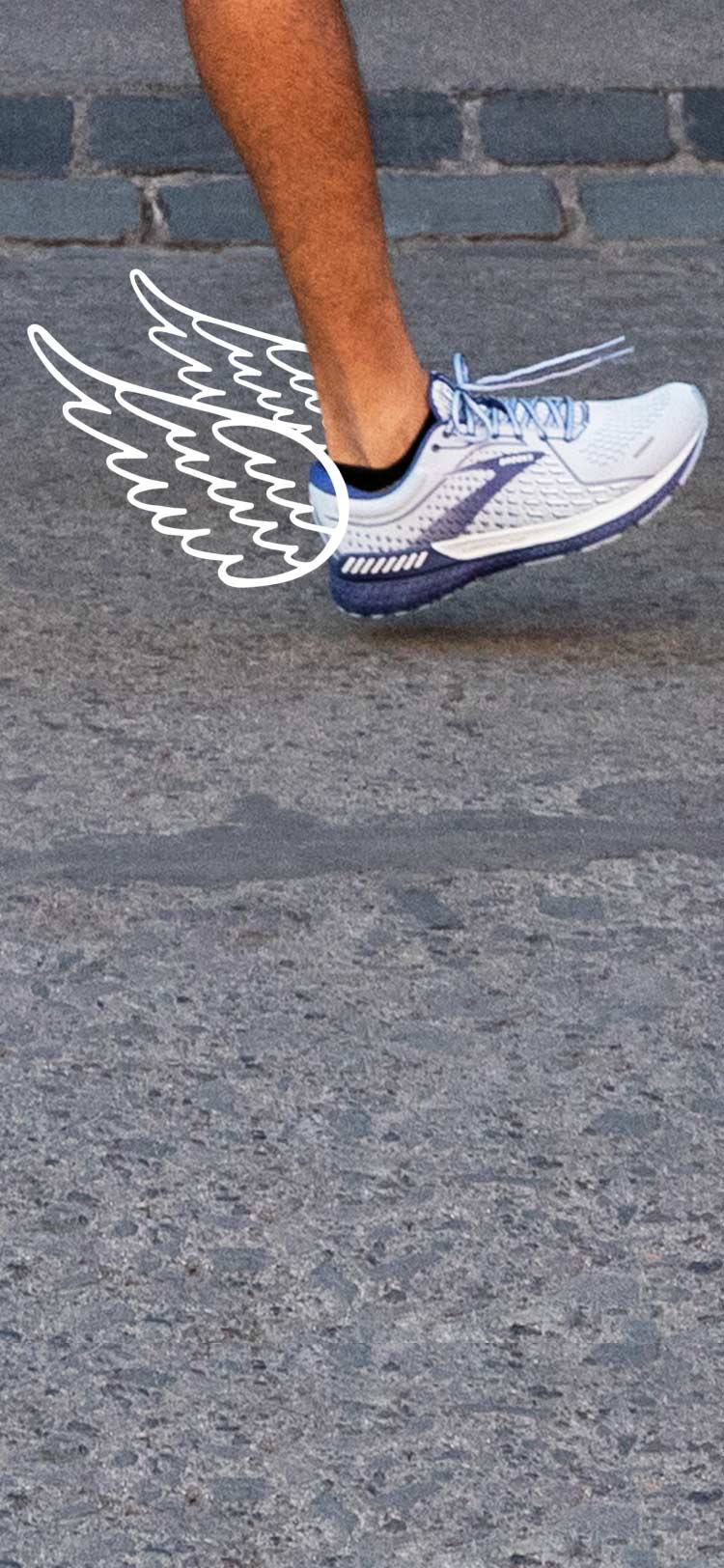 An image of a man from the knee down running outdoors in Brooks Adrenaline GTS 21 shoes with wing graphics that depict a smooth run