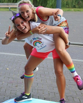 Two women runners posing to the camera