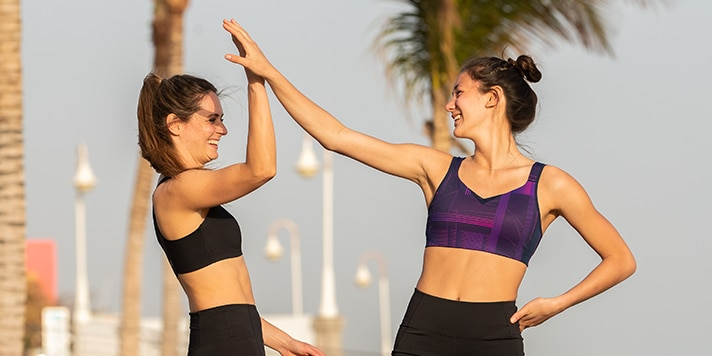 Two women giving each other a high five