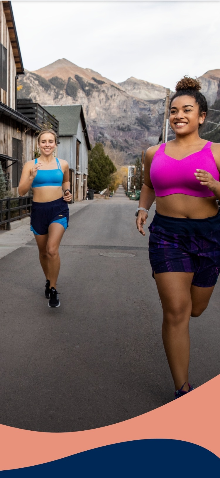 Two women running outdoors wearing the Drive Convertible and Drive Interlace Run Bras