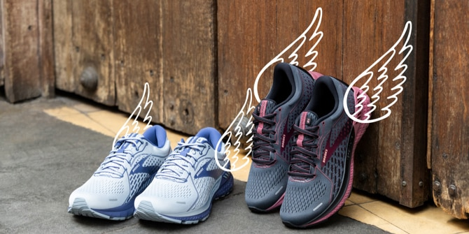 Two pairs of Brooks Adrenaline GTS 21 shoes with wing illustraions on the backs of the shoes