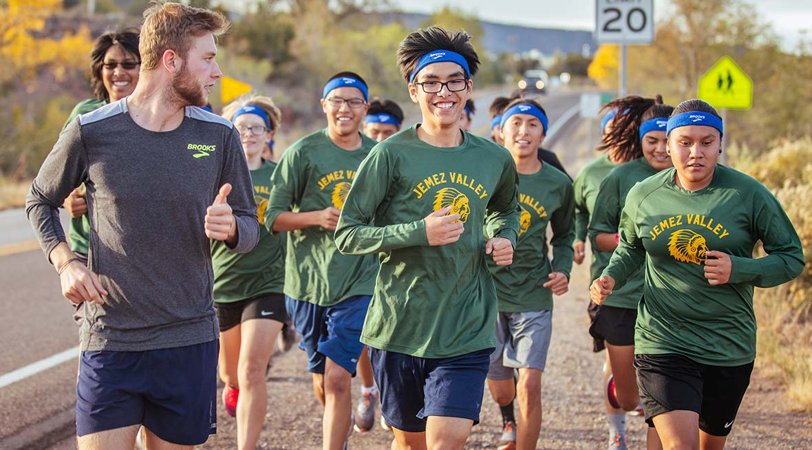 Young athletes running together outside