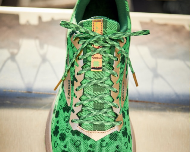 A green shoe with shamrocks from above