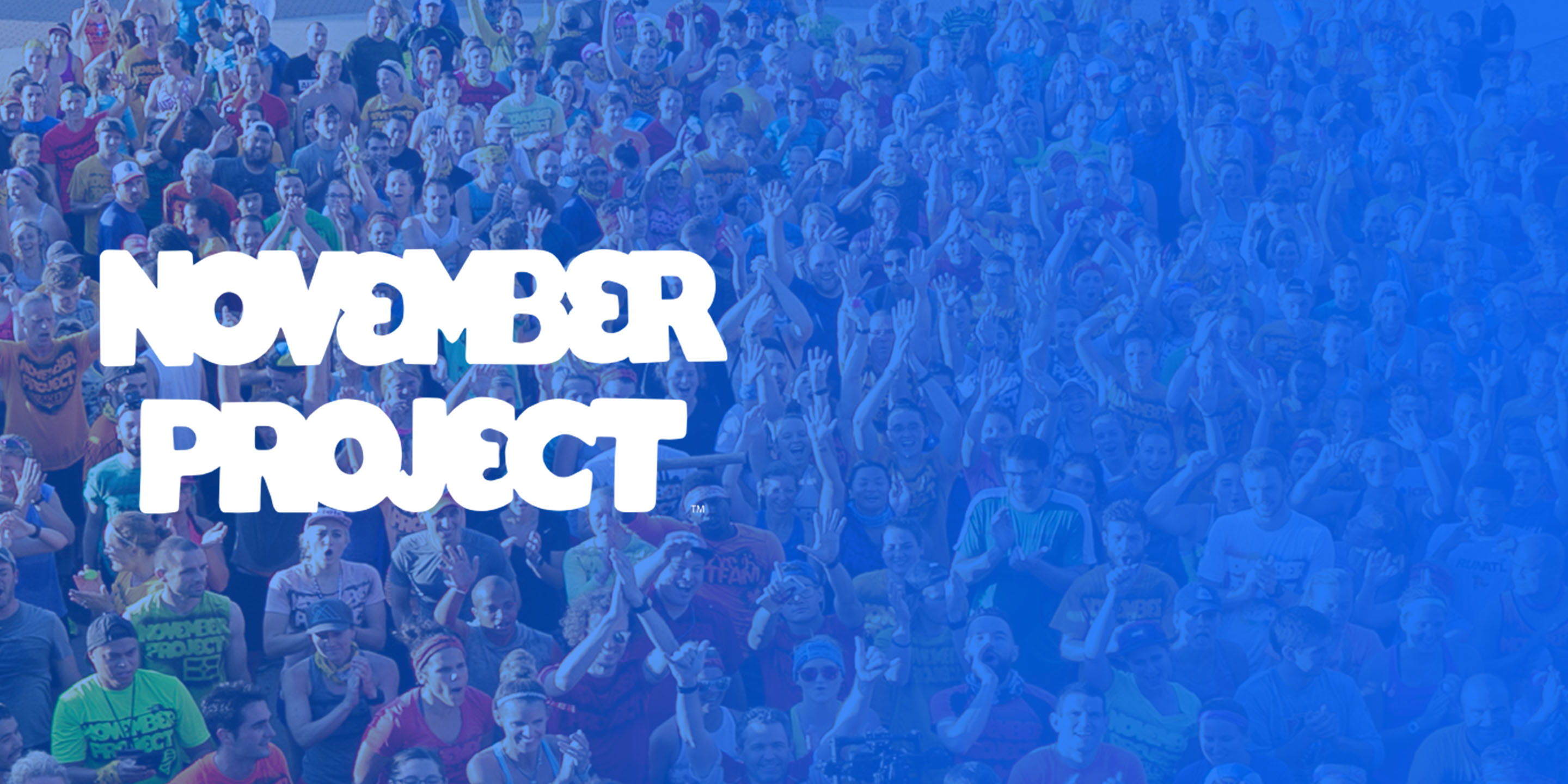 Text that reads 'November Project' over a picture of a crowd