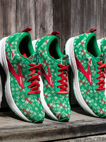 Green and red Brooks shoes lined up