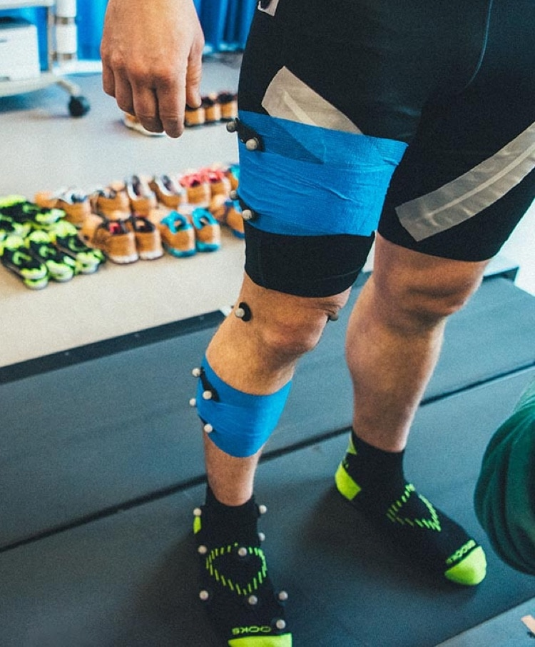 A runner with sensors wrapped around their leg