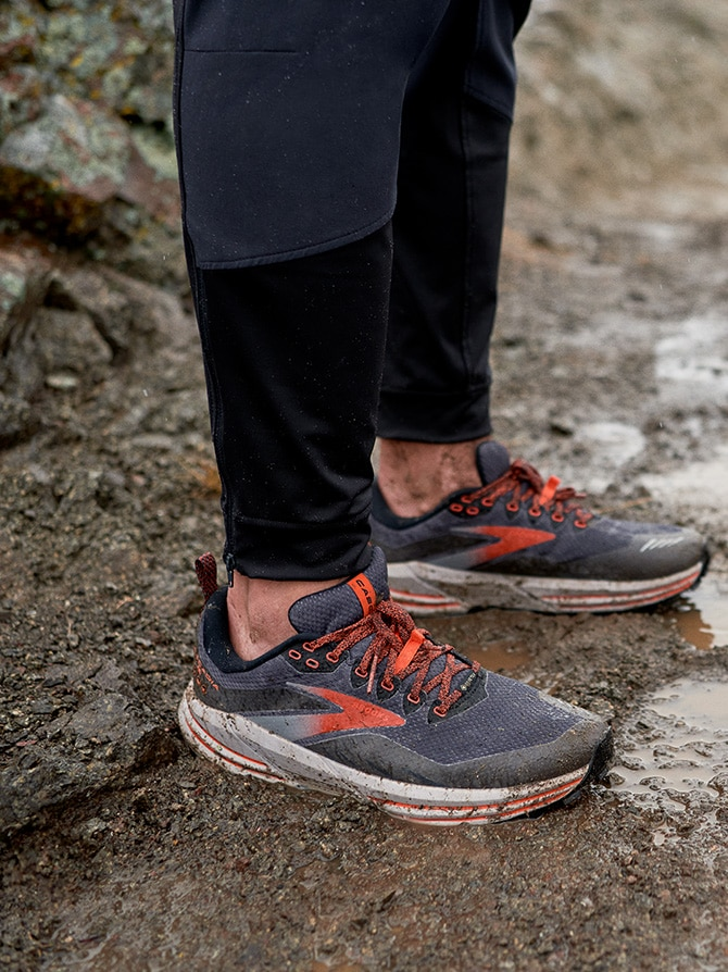 Standing in mud in the Cascadia 16 GTX