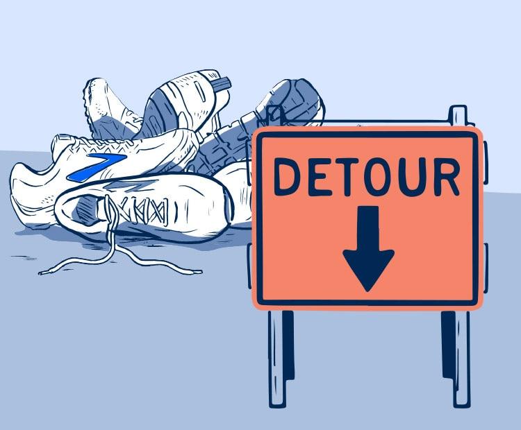 A pile of shoes by a detour sign