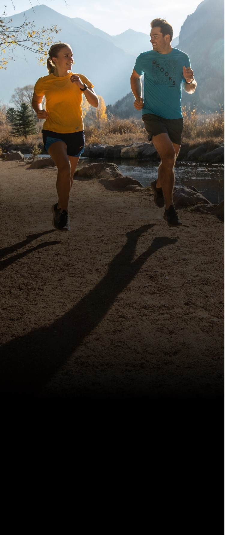 Two runners on a trail