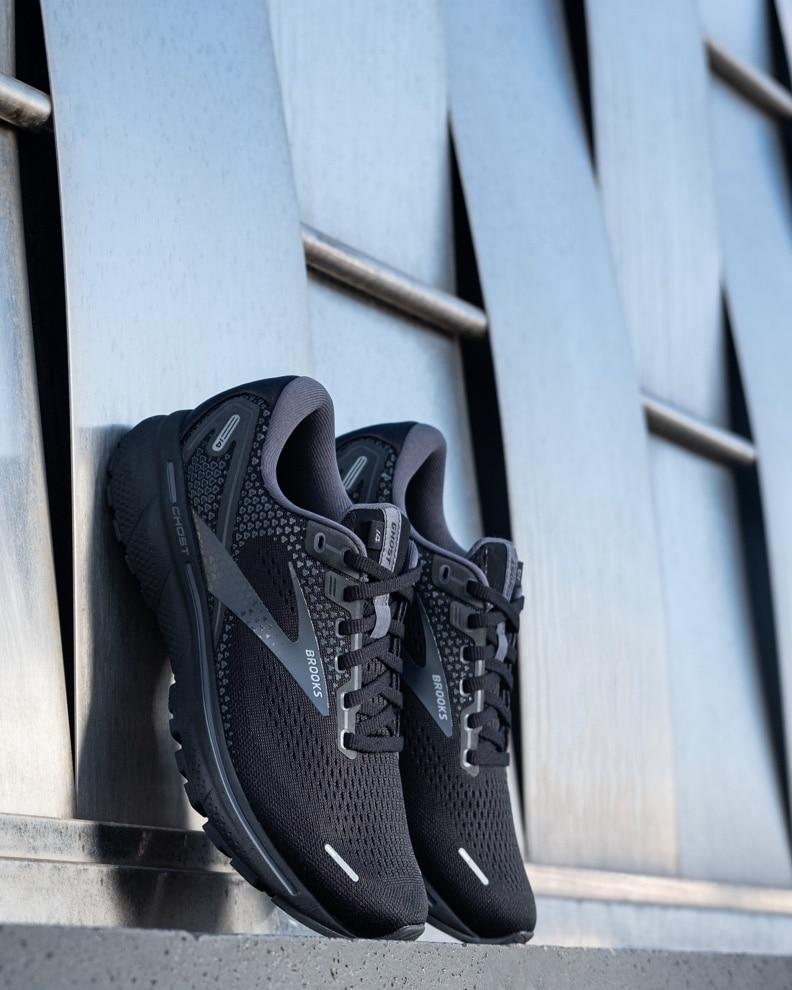 Shoes up against a building