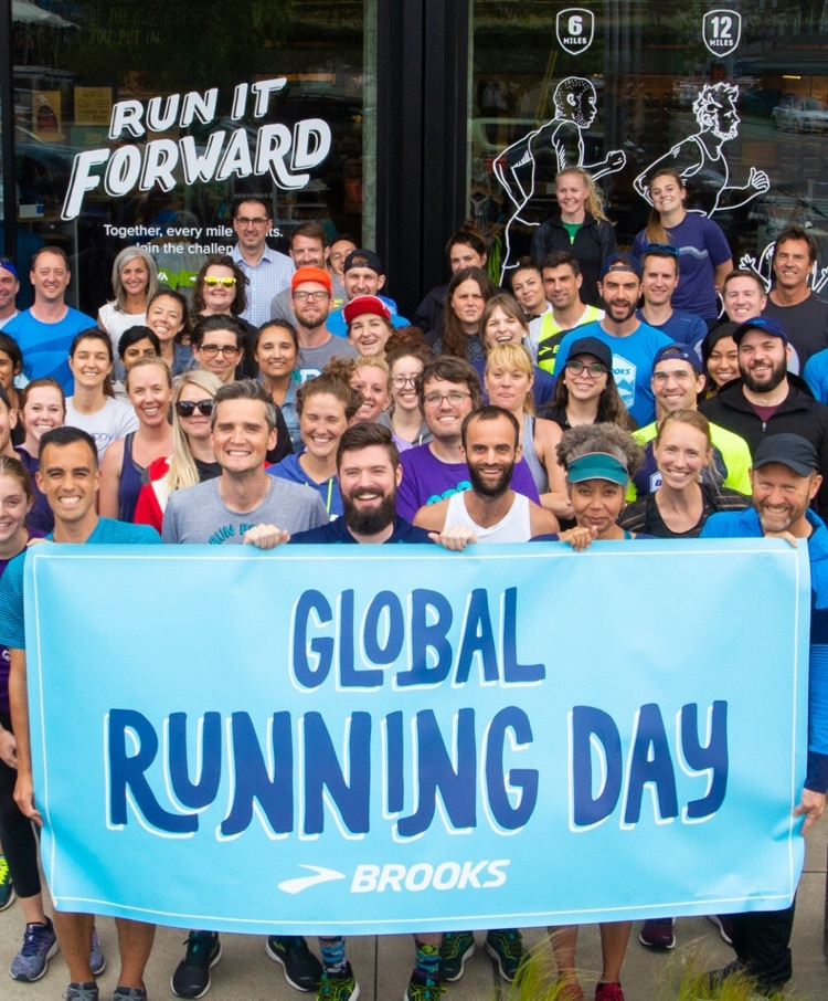 Brooks employees grouped together with a banner