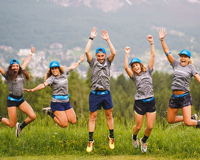 A bunch of runners jumping for a photo