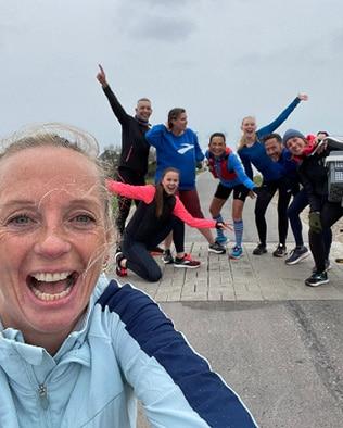 A bunch of runners making a selfie