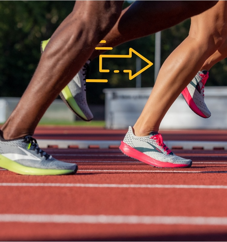 Dos corredores en una pista
