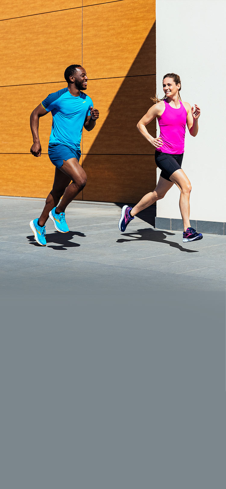A man and a woman running outside in the Ghost 14.