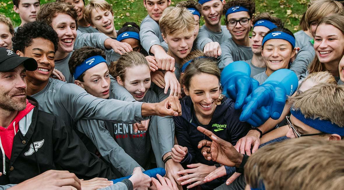 Runners celebrating with Gabe Grunewald