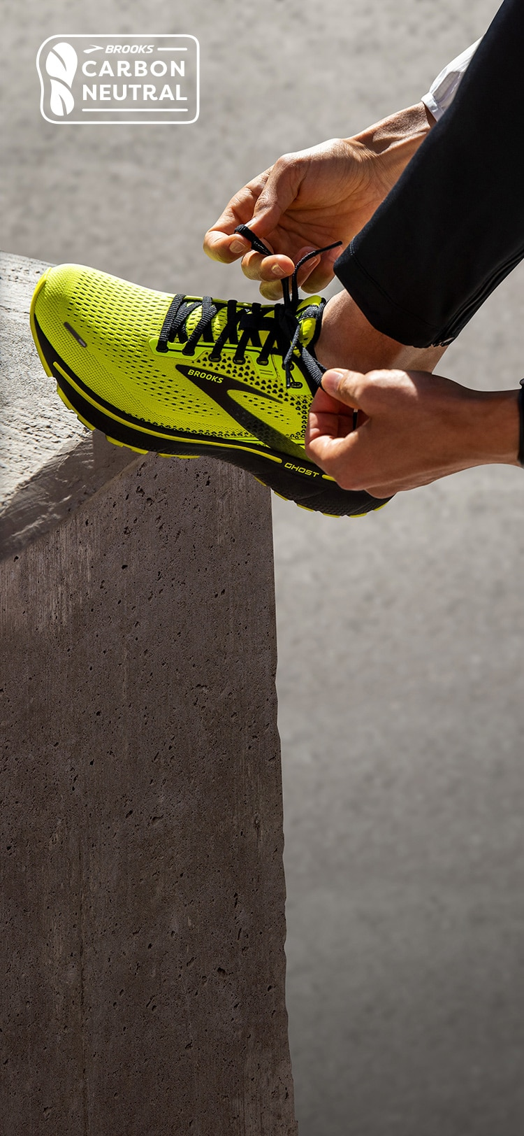 A close up of the foot of someone lacing up the Ghost 14.