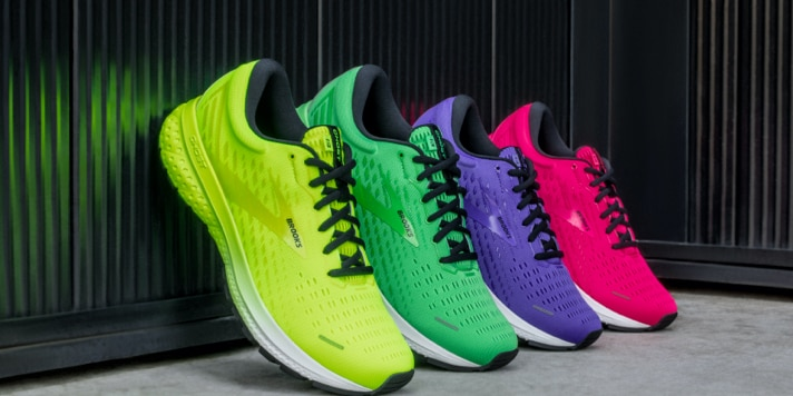 Yellow, purple, pink and green shoes lined up
