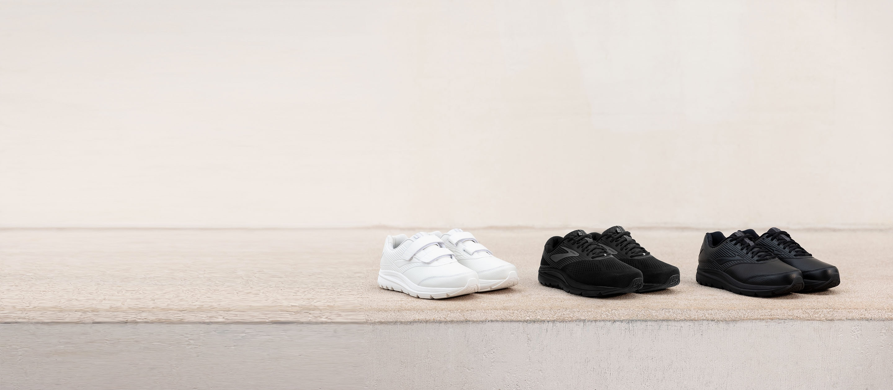 The Addiction Walker 2 V-Strap in white, the Addiction Walker Suede in black and the Addiction Walker 2 in black lined up together