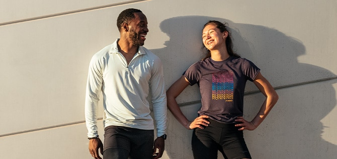 A man and a woman smiling at each other