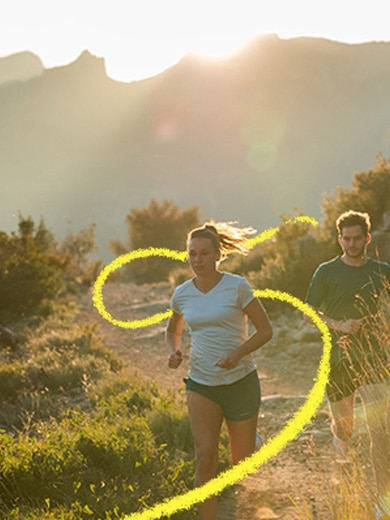 A woman and a man running in the mountains