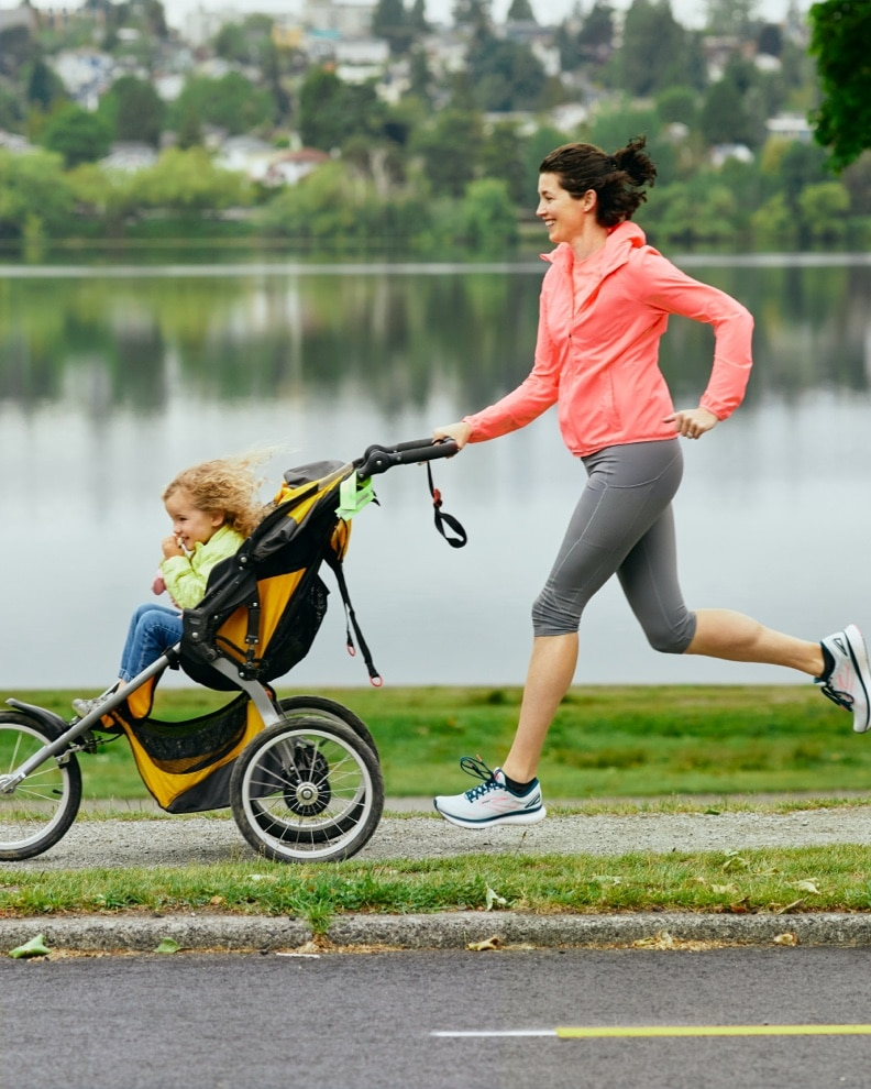 A woman running with a stroller