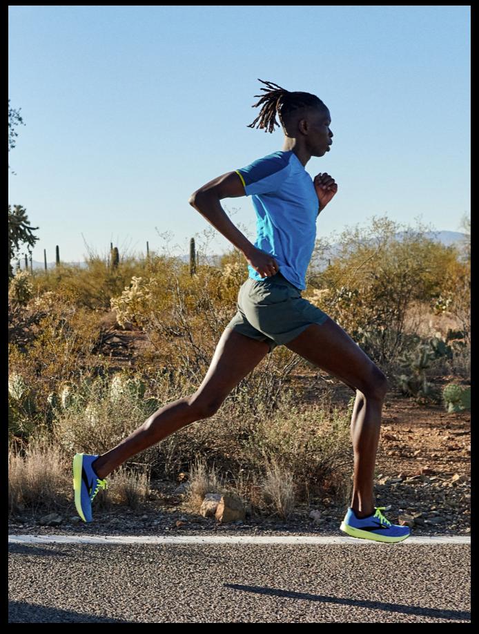 Runner in full stride through the desert