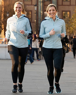 Two women running in a good mood